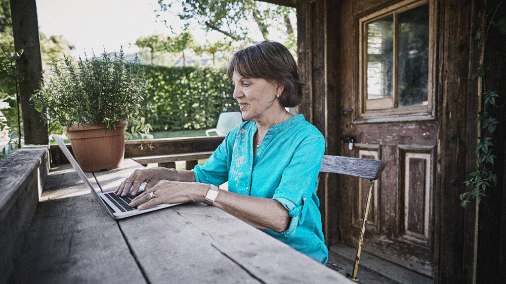 a senior woman on a laptop looking up how to apply for medicare