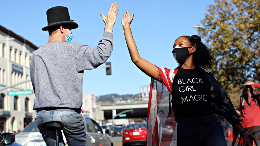 OAKLAND, CA - NOV. 7: Donning a Black Girl Magic t-shirt Lia Ballard of Oakland celebrates on Grand Ave. after Joe Biden captured the presidential victory over Donald Trump on Saturday, November 7, 2020, in Oakland, Calif. (Yalonda M. James/The San Francisco Chronicle via Getty Images)
