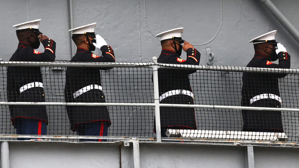 Marines saluting onboard a vessel