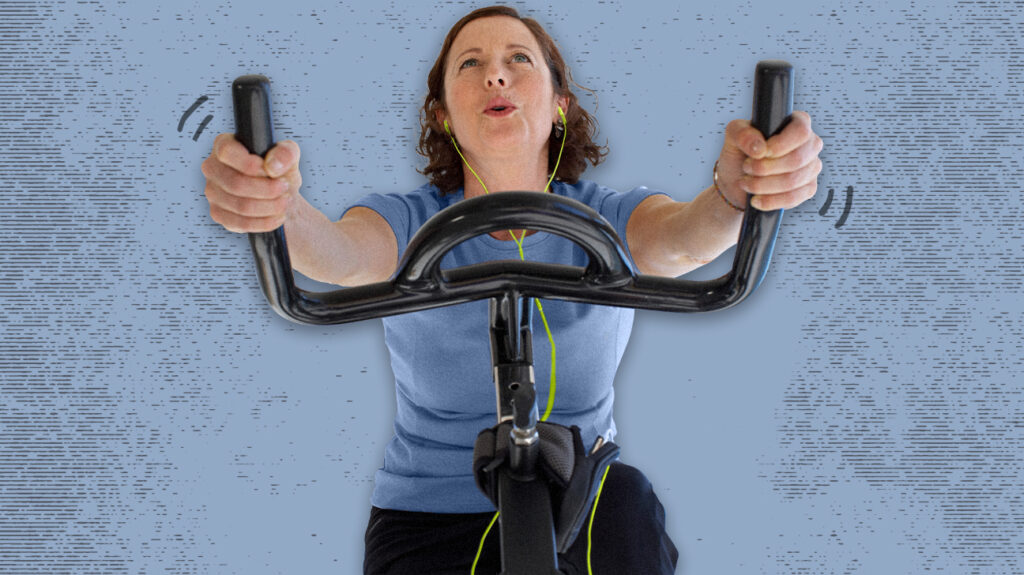 A person working out on an exercise bike