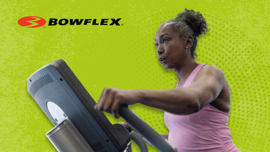 Woman exercising on Bowflex home gym next to logo isolated over green background