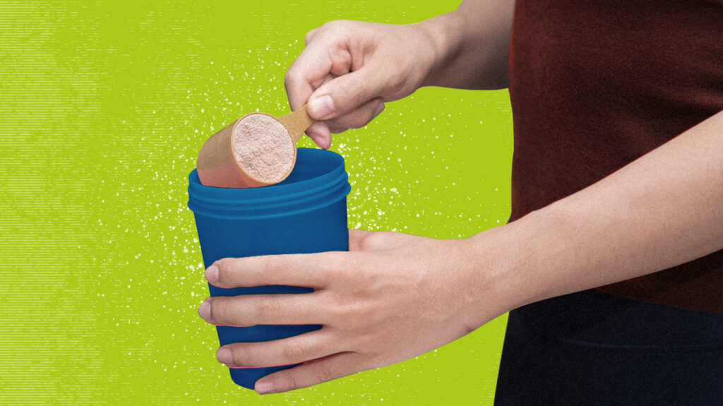 Close up of woman's hands measuring protein powder into a cup isolated over bright green background.