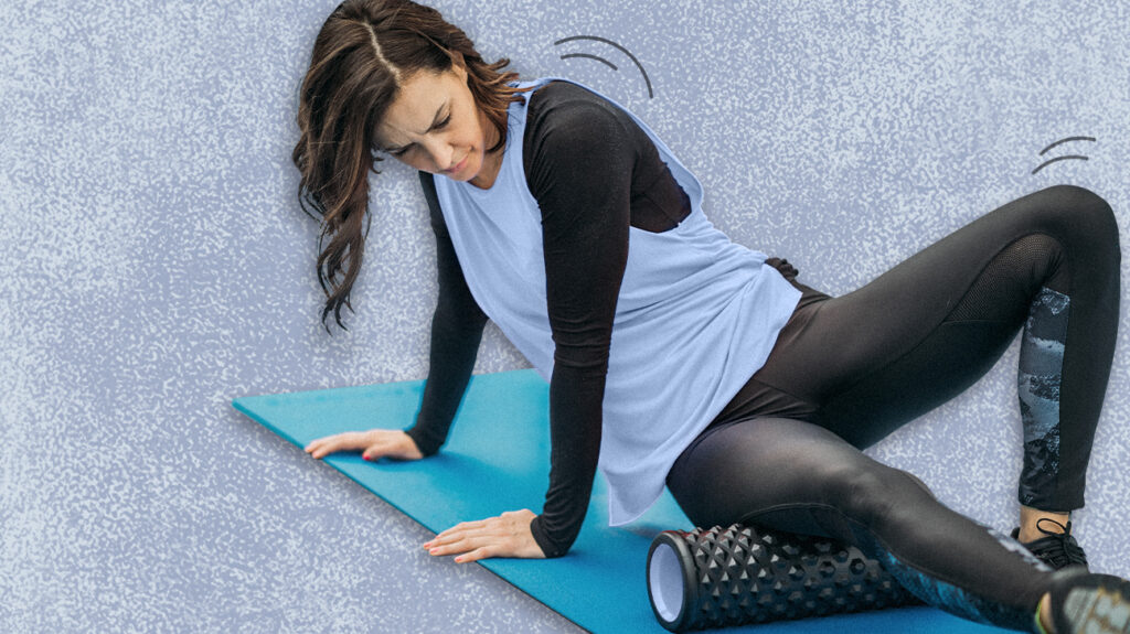 a woman on a foam roller