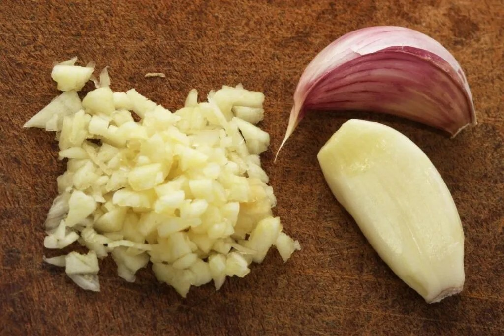 Pealed and grated garlic on a table