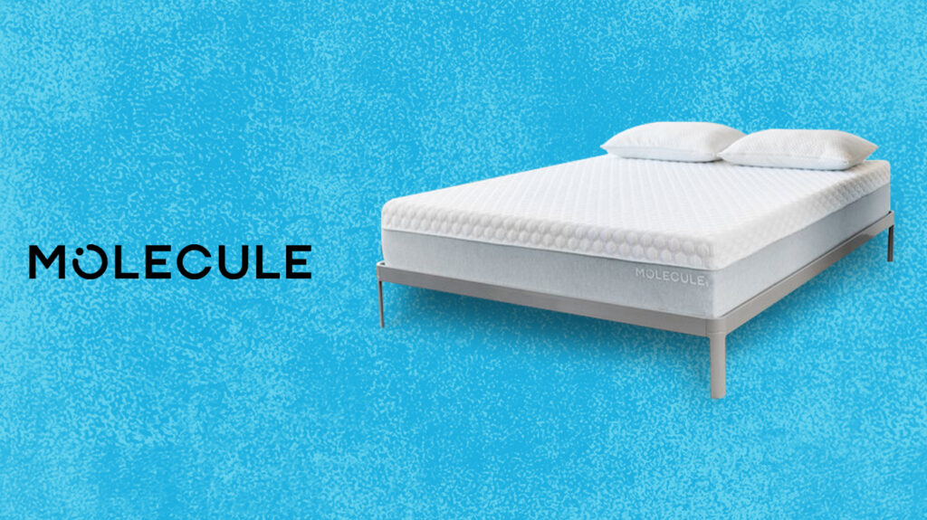 Molecule mattress on bed isolated over dappled blue background next to Molecule logo