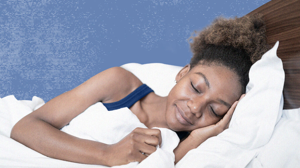 Woman asleep in bed on memory foam pillow