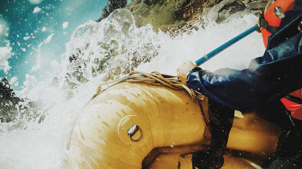 Close up of white water rafting.