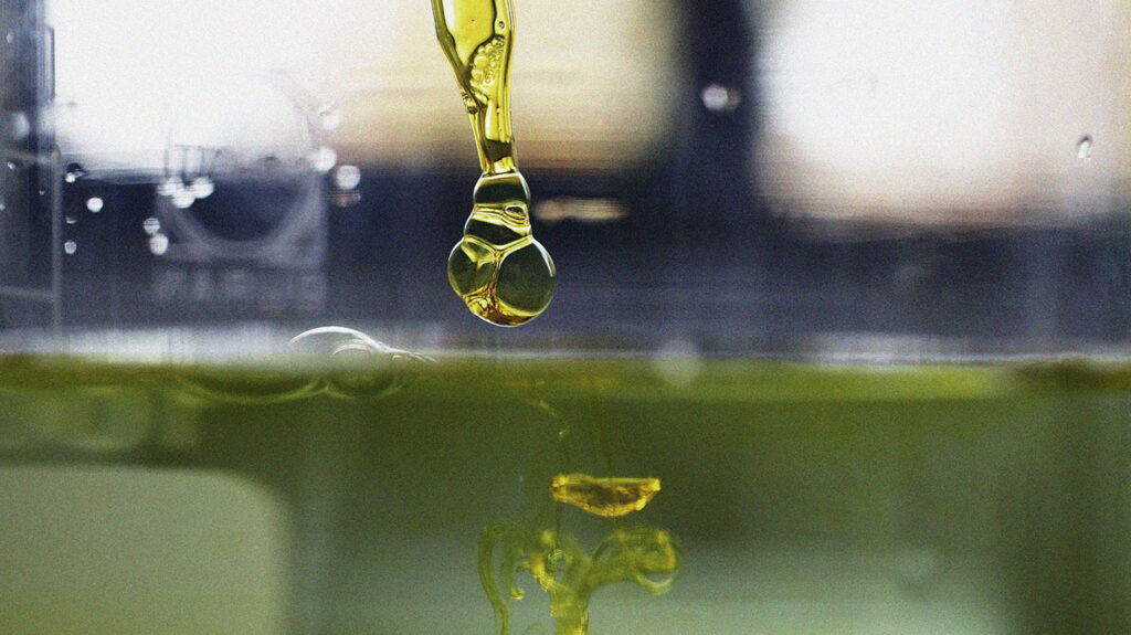 A sample of CBD oil coming out of a dropper.