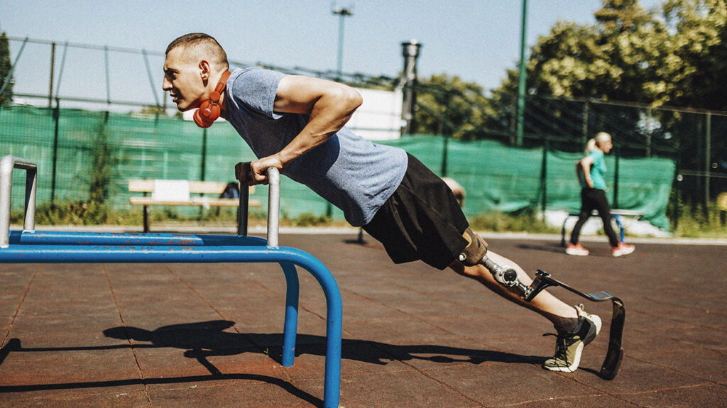 a man performs incline pushups as part of a calisthenics workout plan