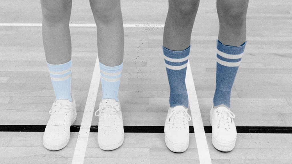 A photoillustration in black and white with tube socks in blue to illustrate what can cause socks to leave marks on legs.