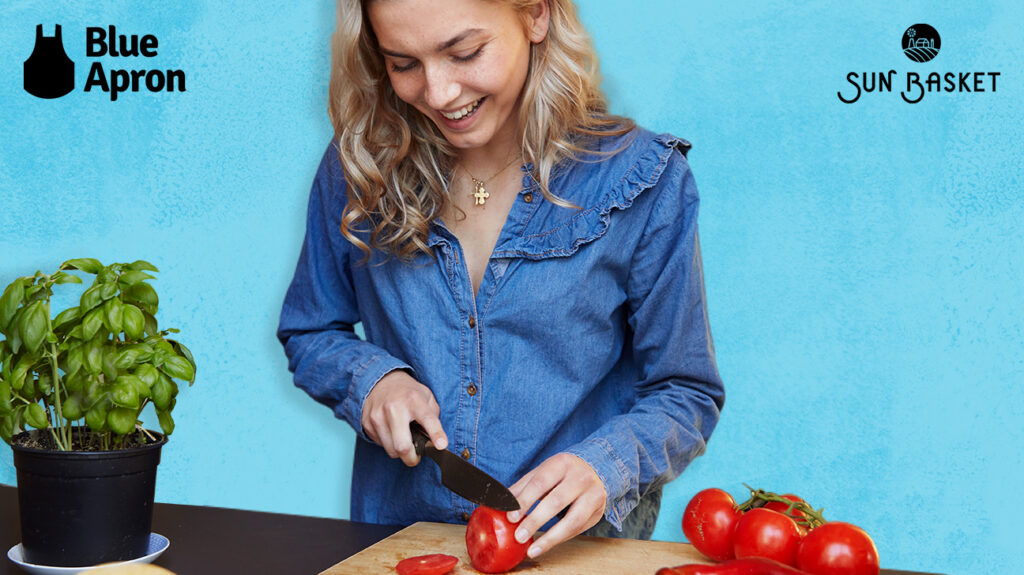 woman chopping up vegetables over blue background next to blue apron and sun basket logos