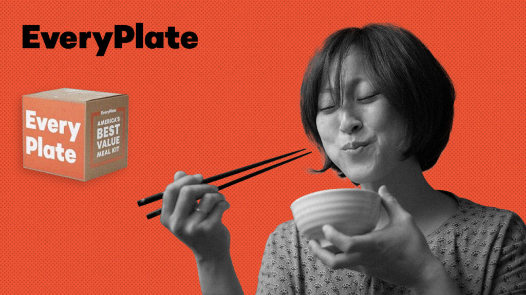 black and white photo of a woman using chopstick to eat meal out of a bowl isolated over red background next to everyplate logo
