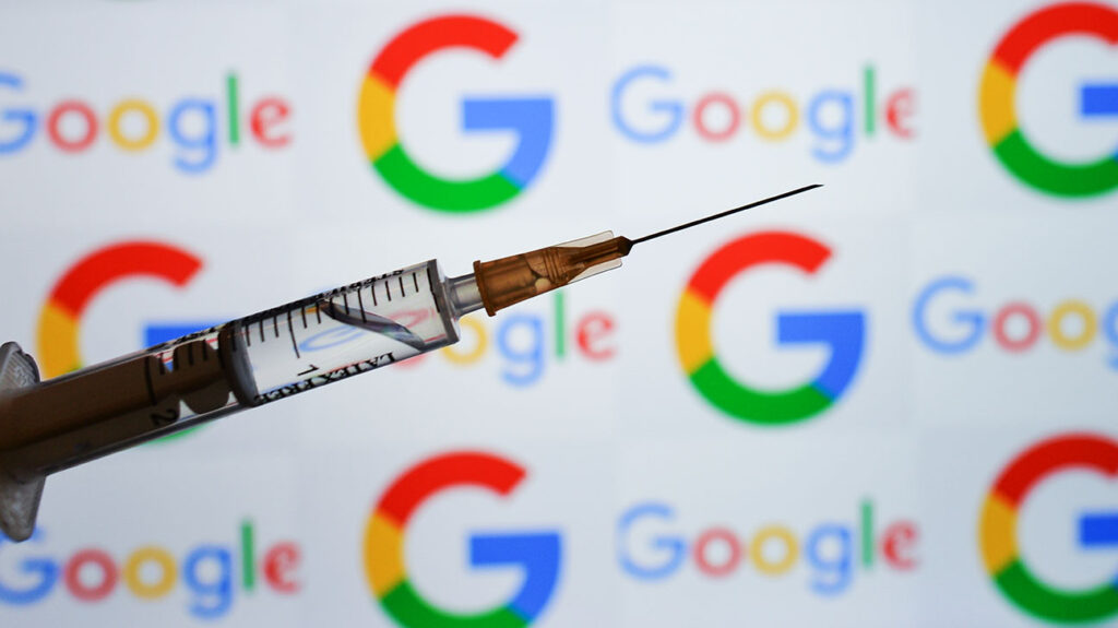 Hypodermic needle in front of Google logo