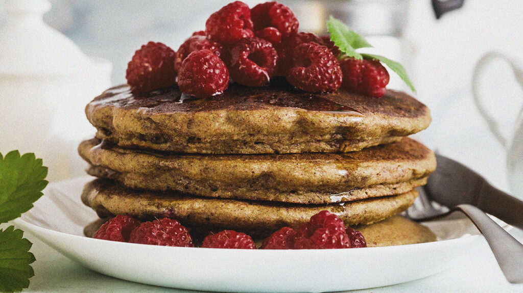 A low GI option of gluten-free green buckwheat pancakes with fresh berries and maple syrup.