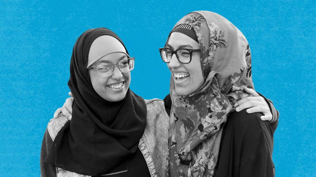 Black and white photo of two women wearing headscarves and eye glasses from eyeconic, isolated over blue background