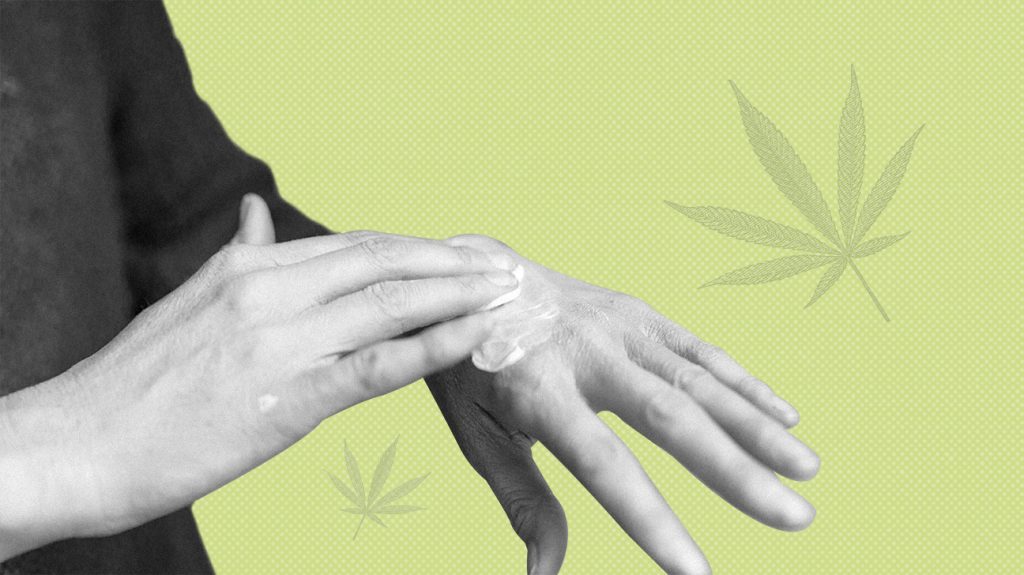 Black and white photo of a person rubbing CBD skin cream into back of hand over green background