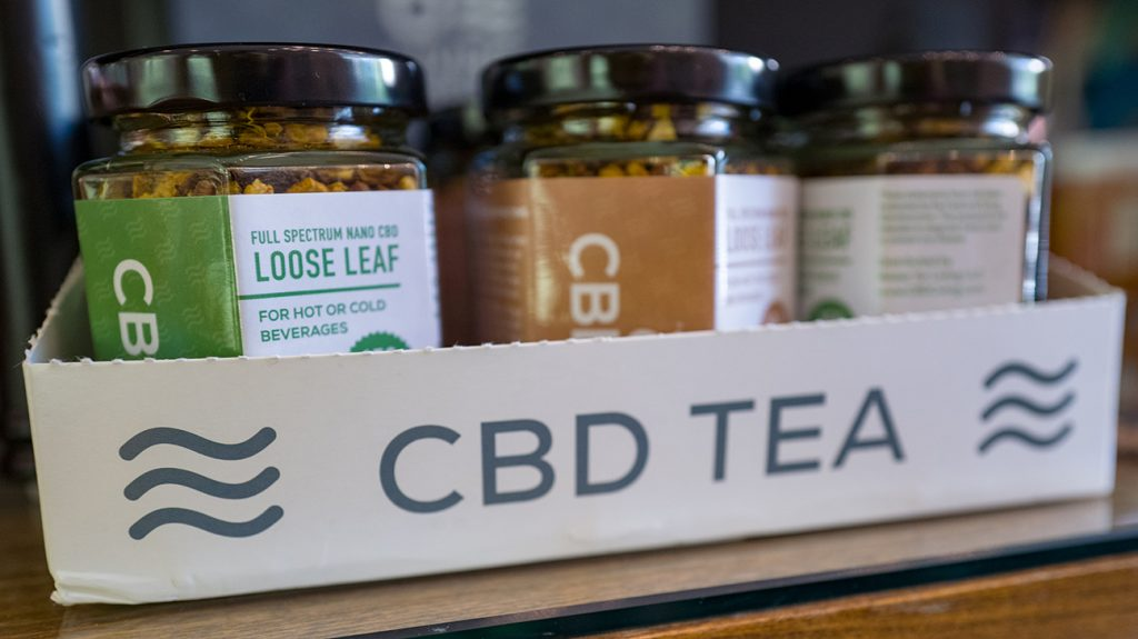 CBD teas in tray in shop
