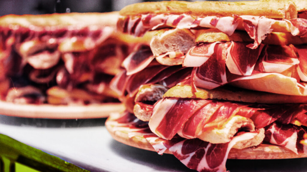 close up of sandwich with bacon rashers