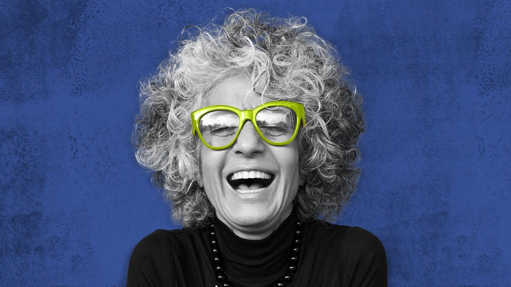 Adult female laughing wearing large square frame glasses possibly after researching the best glasses for astigmatism