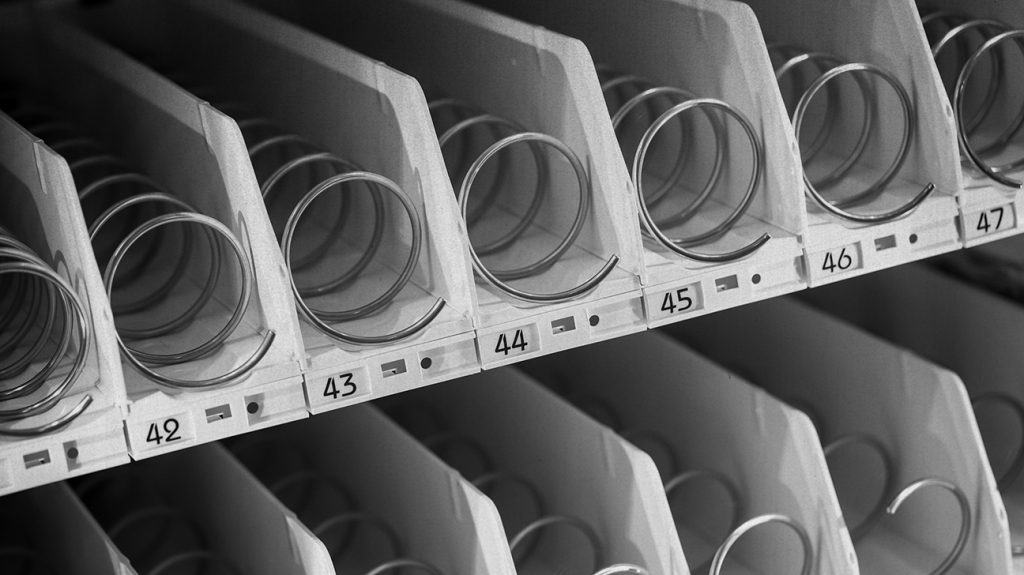 an empty vending machine is shown in black and white