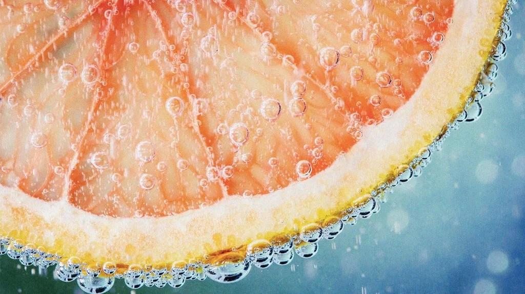 grapefruit slice in sparkling water