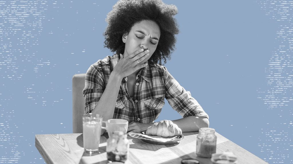 Black and white photo of woman in front of food covering mouth wondering if she should take an at-home food sensitivity test, isolated over blue-gray background