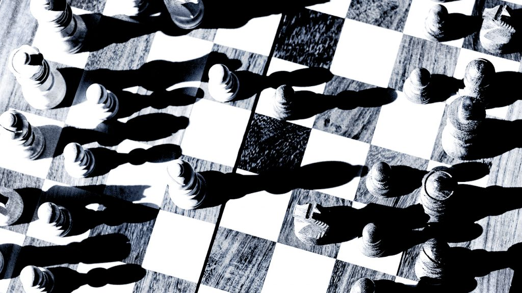 A chess board photographed from above with long shadows