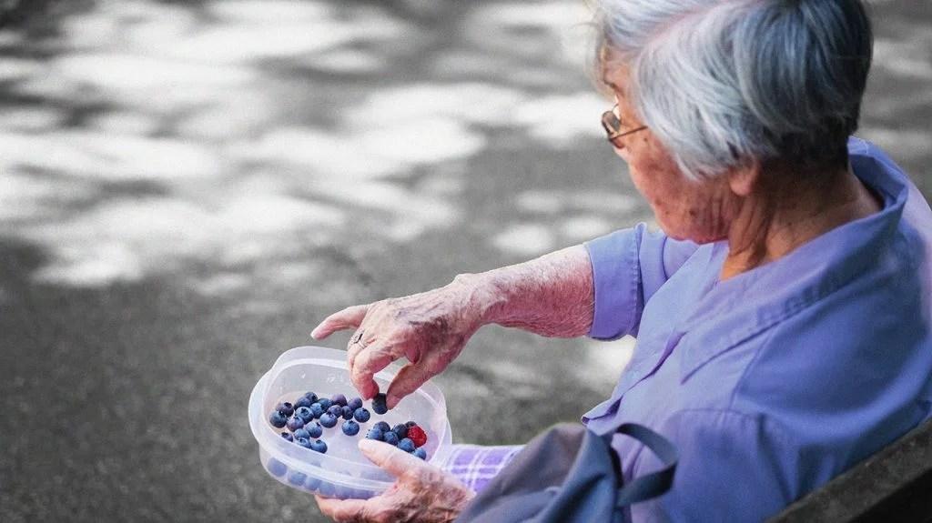 Someone who eats blueberries outside