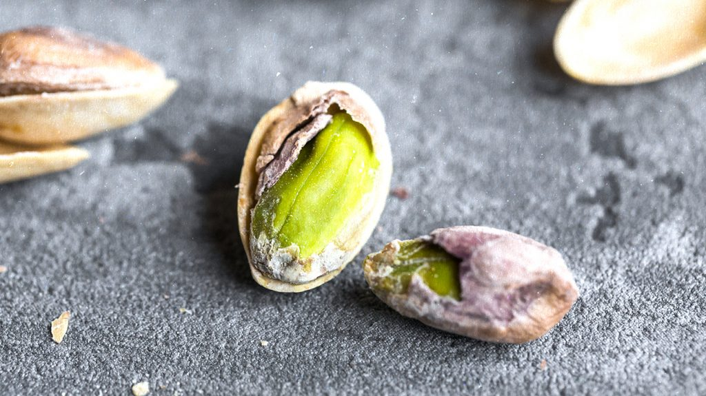 Partially peeled pistachio nuts