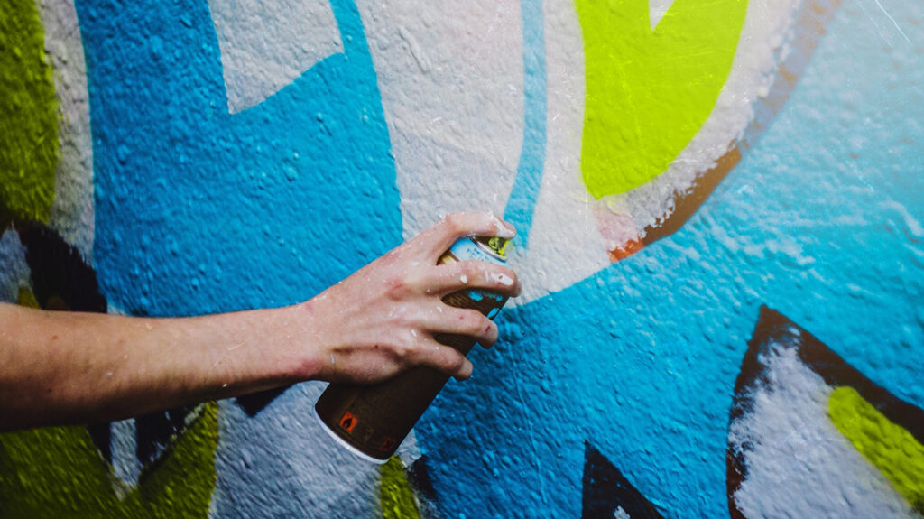 An image of a person using spray paint