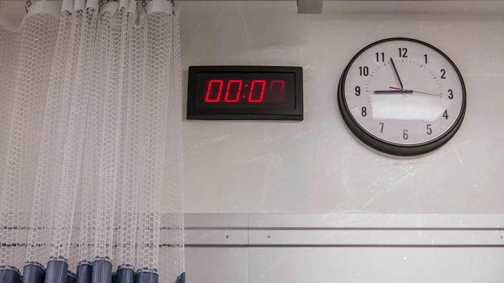 digital and analogue clocks on a wall