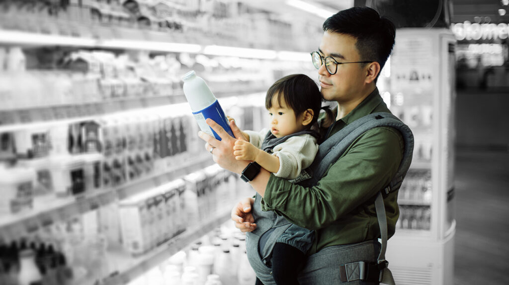 father and baby daughter purchasing milk