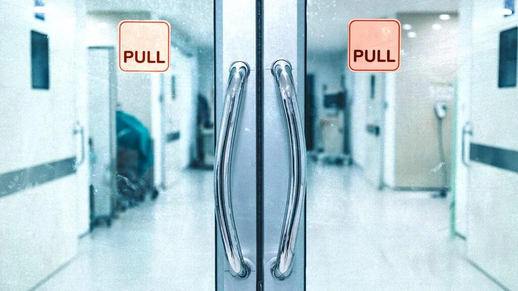 Looking through hospital doors