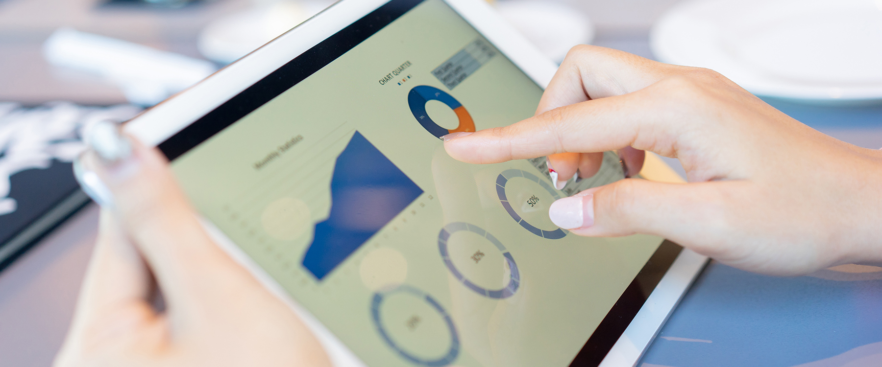 Woman clicking on graphs on ipad