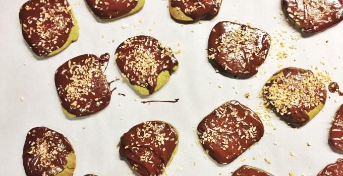 Matcha shortbread cookies dipped in dark chocolate