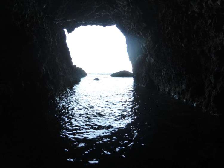 The cave starts quite high in the beach and winds its way down to the sea