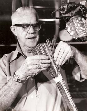 MacDonald using straws to make sound effects, circa 1950s.