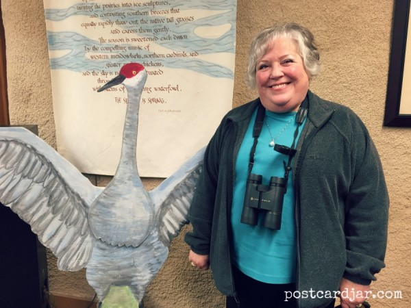 My mom next to a life-sized cut out of a Sandhill Crane.