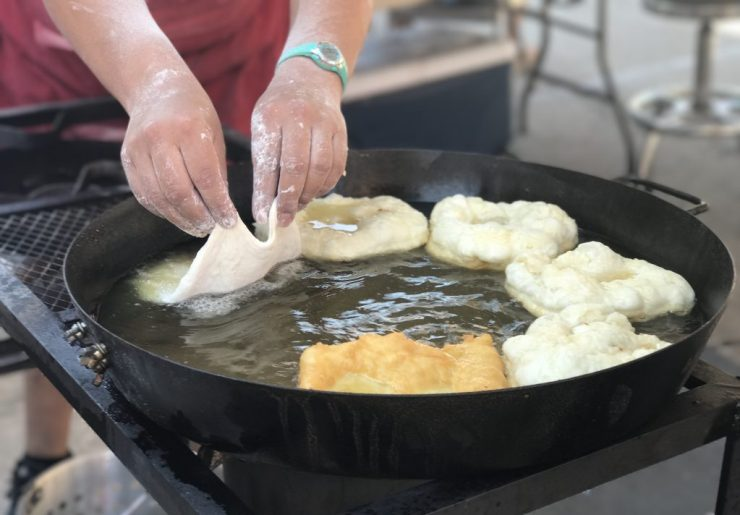 Indian Taco fry bread being cooked in oil at the National Indian Taco Championships in Pawhuska, Oklahoma.