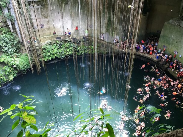 Swimming in the crowded cenote.
