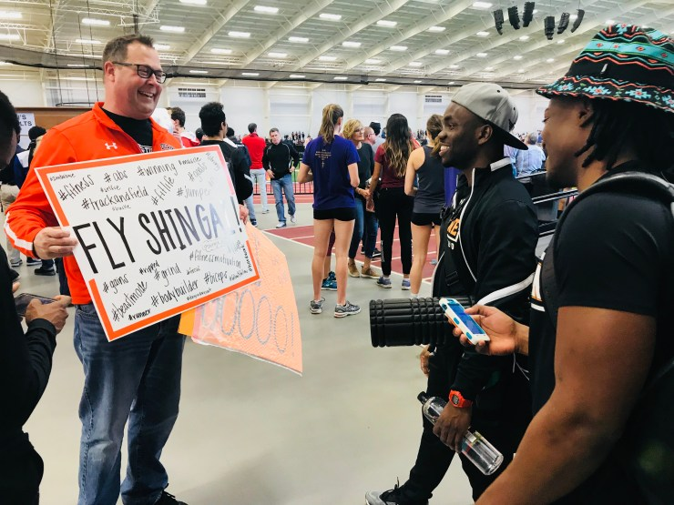 Showing the guys the signs we made to cheer them on at the NAIA National Track and Field Championships in Pittsburg, Kansas