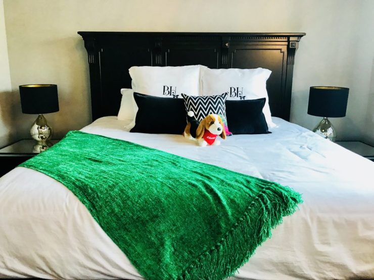 Each room at The Pioneer Woman Boarding House has luxurious bedding, an accent blanket, and a stuffed animal from The Mercantile.
