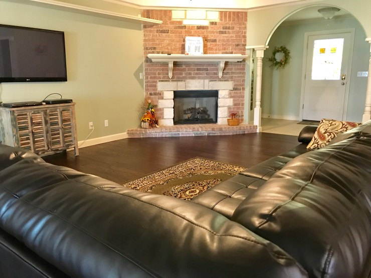 There is a large living room and open floor plan at Redbud Cottage in Pawhuska.