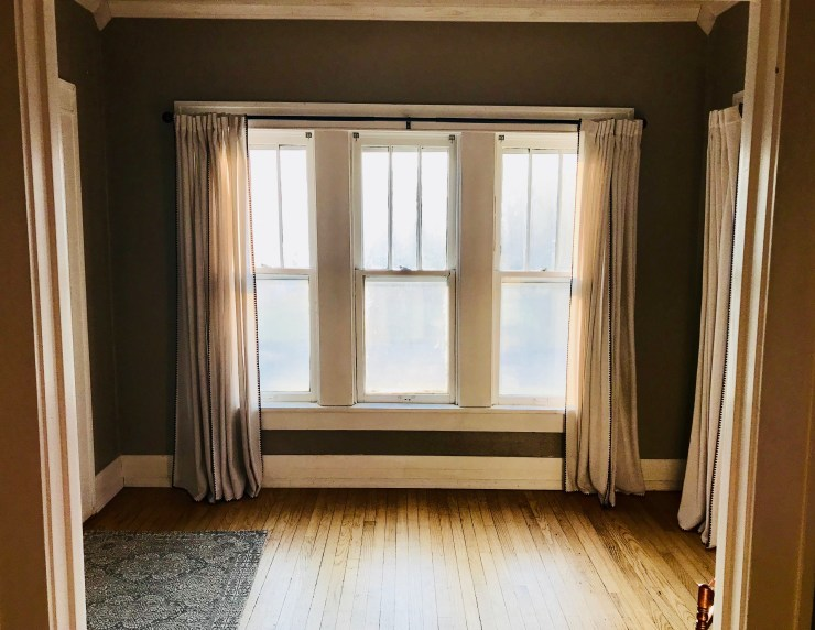 We love the bright entryway that the front door opens into. Not sure exactly what we're going to do with this space yet, but Ann is already picturing a Christmas tree in the window.