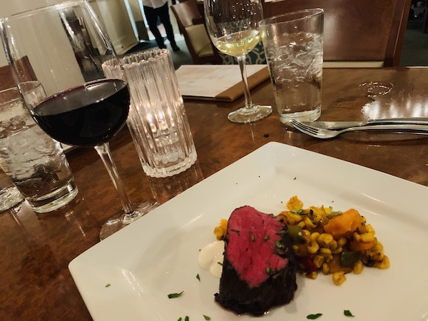 Red wine poached beef tenderloin with butternut squash succotash.
