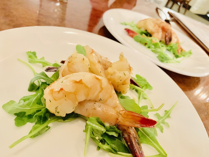 Grilled marinated shrimp with arugula.