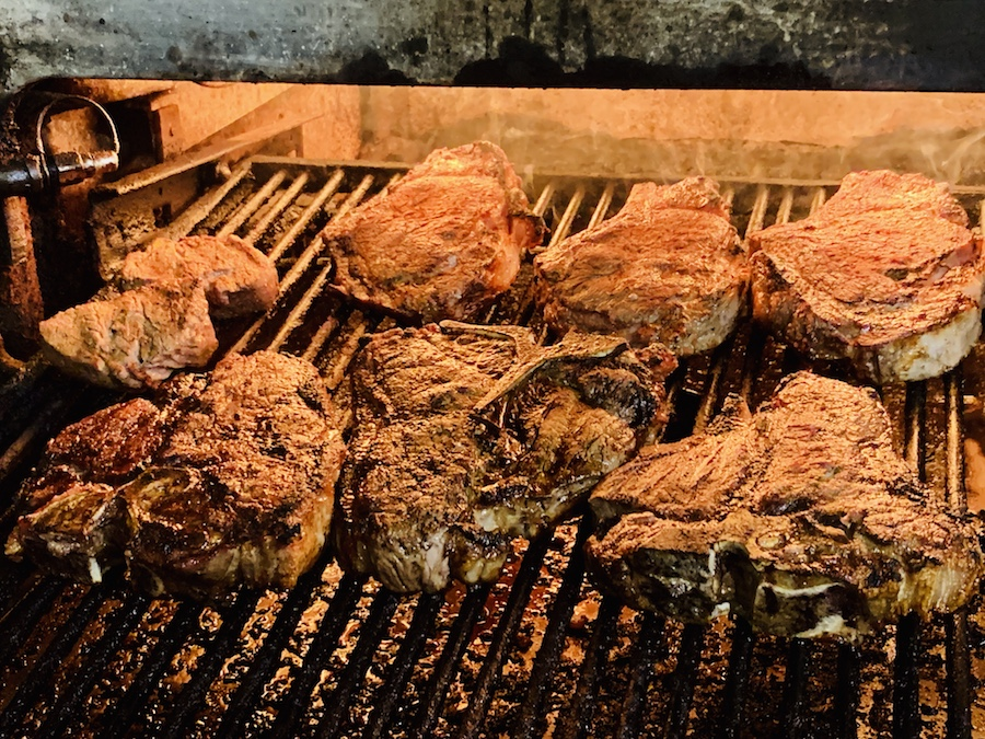 Doe's Eat Place steaks broiling