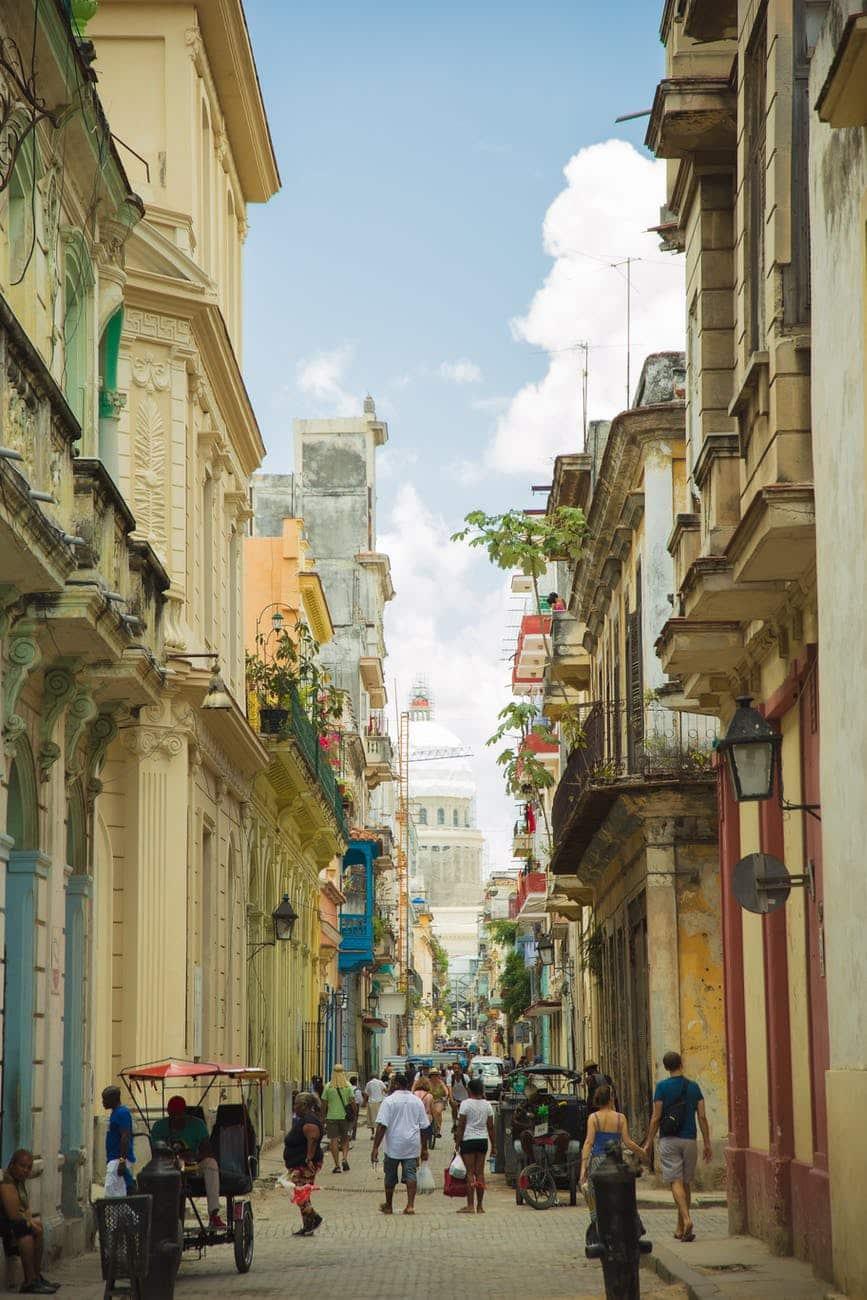 narrow pedestrian street between historic classic buildings