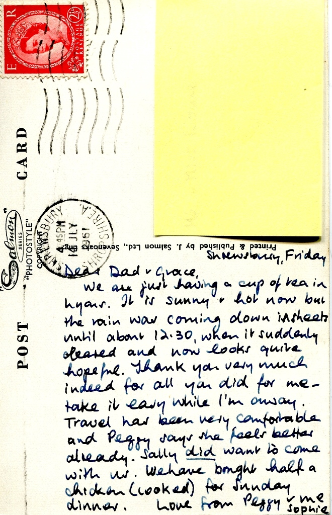 Neat handwriting on old postcard