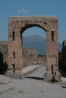 Arch, located to the left of the main temple, through which Mt Vesuvius is visible.